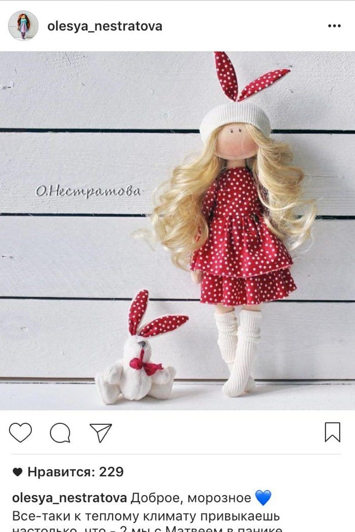 The doll is positioned according to the rule of thirds.  In addition, there is a rhythm in the photo - repeating stripes of boards